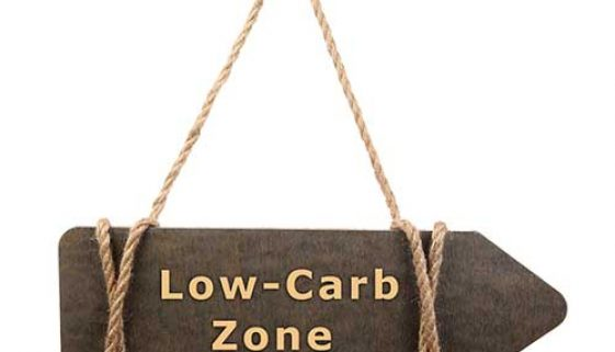 Wooden board hanging on rope with text Low Carb Zone isolated on